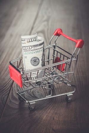 one hundred dollars: one hundred dollars in the shopping trolley