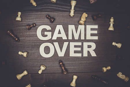 over: game over concept on the brown wooden background