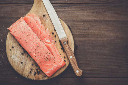 hardboard: salted trout on the hardboard and knife