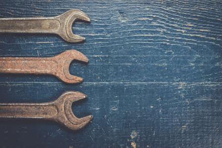 screw key: old rusty screw keys on the blue table