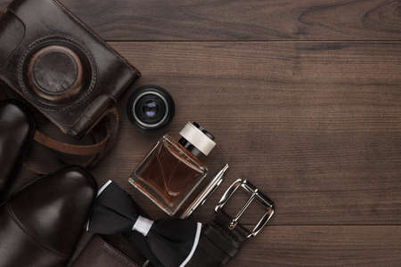 men's accessories in order on the brown wooden table overhead view with copy space Stockfoto