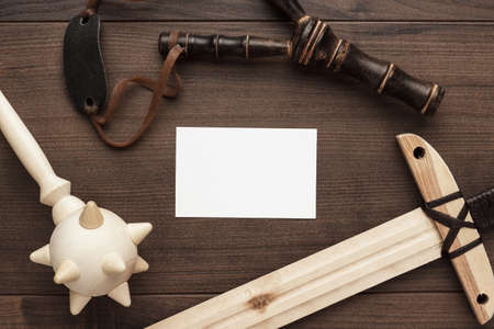 strip club: handmade wooden training toy sword and slingshot on the table with copyspace Stock Photo