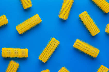 hair curlers: yellow hair curlers on the blue background
