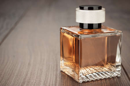 table set: perfume bottle on the brown wooden table background