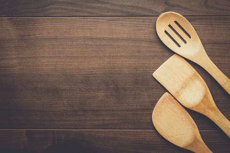 kitchen tools: different wooden kitchen tools on the table with copy space