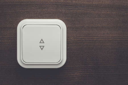 indoor inside: white plastic light switch on the wall