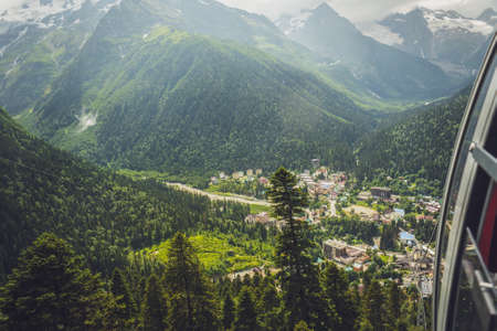 dombay: view from cableway cabin on small town in the mountains. alpine landscape