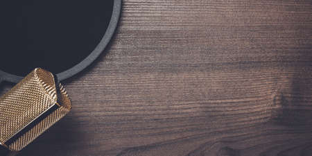 condensing: vintage condensing microphone and pop filter over wooden background