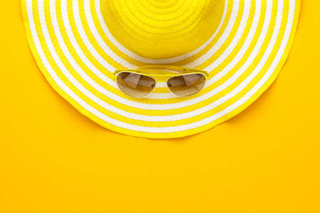 protecting spectacles: yellow sunglasses and striped retro hat. summer concept Stock Photo