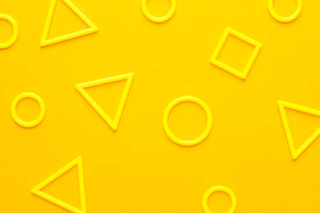 photo of different 3d printed plastic geometric shapes on yellow background