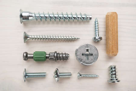 assorted screws for furniture assembly on the wooden table