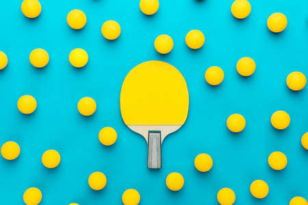 Racket and many balls for table tennis on turquoise blue