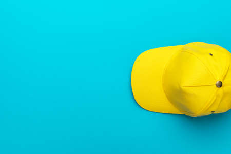 Top view of the yellow baseball cap over the blue turquoise