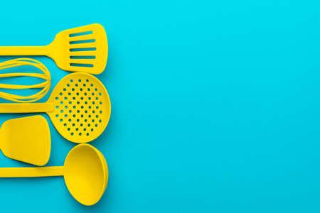 Top view photo of vivid plastic kitchen utensils.
