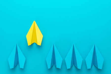 Top view of yellow paper plane as out of the crowd concept over turquoise blue  with copy space.