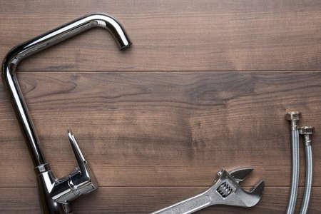 Top view of plumbing tools on brown table. Zdjęcie Seryjne