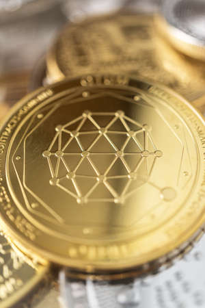 Physical coin on the stack of other different cryptocurrencies.
