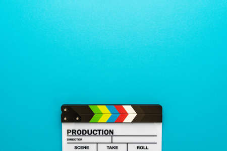 Top section of white clapperboard at the bottom of turquoise blue