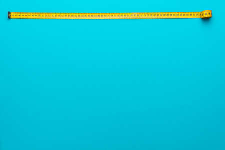 Top view of yellow soft measuring tape.