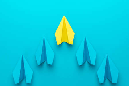 Leadership concept with paper planes over turquoise blue