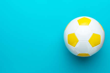 Top view  of white and yellow soccer ball as football concept Zdjęcie Seryjne