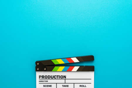 Top section of white clapperboard at the bottom of turquoise blue  with copy space