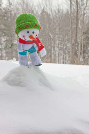 Snow man about to start skiing