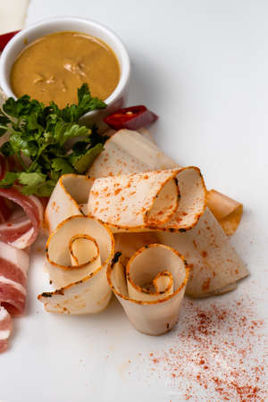 Meat assortment: slicing meat and lard with mustard, green onions and herbs. Pork, beef and bacon. Stock fotó