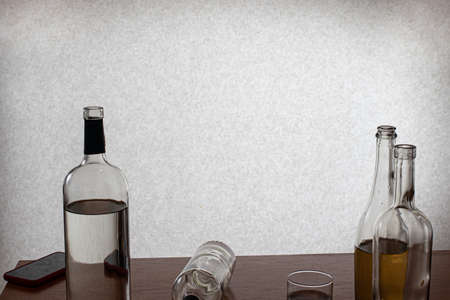 Empty vodka bottles. Alcoholism is a social problem. Depression, alcohol withdrawal and dependence. 写真素材