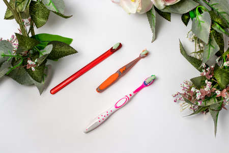 Three toothbrushes for the whole family. Care for the mouth, brushing teeth. Toothpaste and toothbrush. Reklamní fotografie