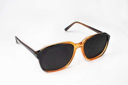 Perforated glasses with holes. Plastic glasses simulators to relieve eye strain and improve vision.