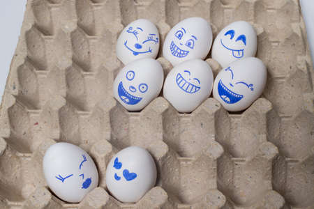 Funny chicken eggs. Smiley eggs with faces, funny faces. Eggs with different emotions: laughter, smiles, fear, anger, scream, tears.