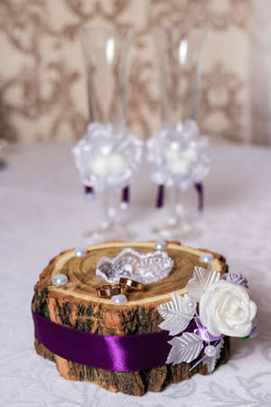 Gold wedding rings on a casket