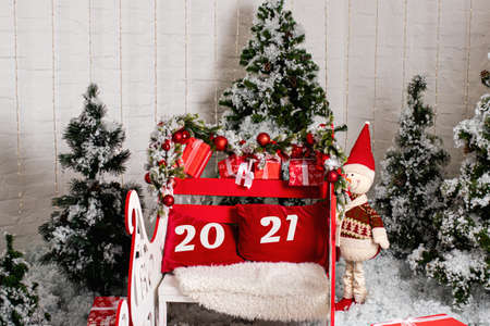 Santa's red sleigh, snowman and Christmas trees