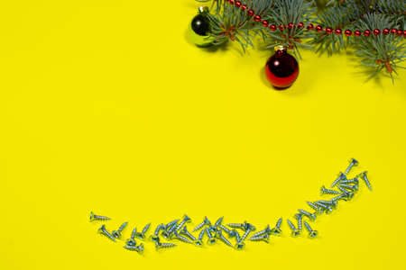 Metal self-cutters on a yellow background with a Christmas tree and a ball. New Year's banner for the workshop and building materials store.