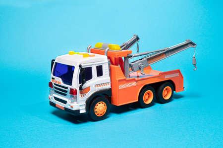 Children's construction machine on a blue background.