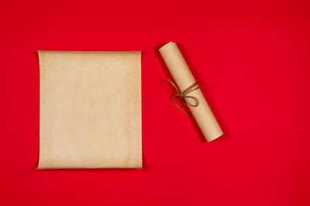 Parchment scroll for the to-do list on a red background. Glider, day planning, place for text and for entries. Copyspace. Old paper.