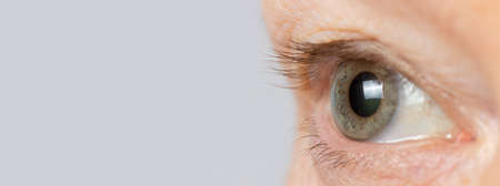 The eye of an old man, an aging eye and a body, old age. Cosmetics for eyes, cosmetology and ophthalmology for women after 50 years