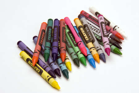 Multi Coloured Crayons set against a plain backgrund.