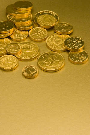 Gold Chocolate Coins set against a gold background. photo