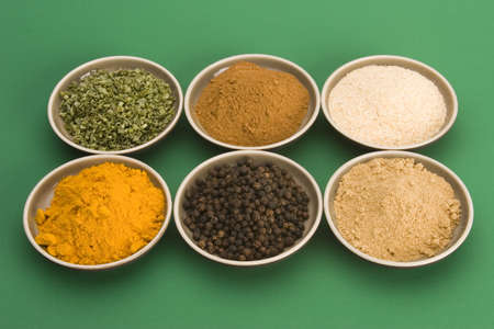 Spice bowls against a plain background.