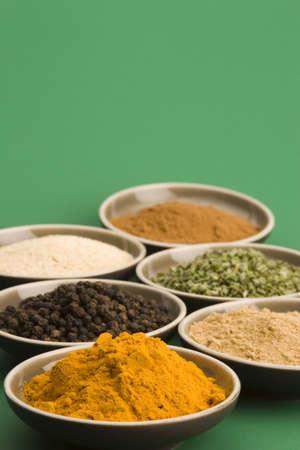 Spice bowls against a plain background.