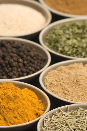 Spice bowls against a plain background. Stock Photo - 687581