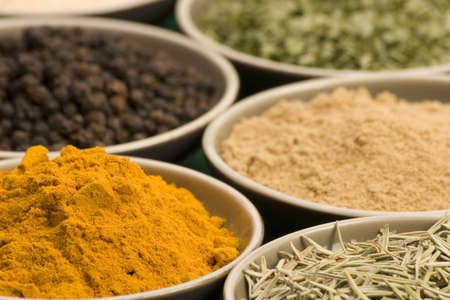 Spice bowls against a plain background. Stock Photo - 687578