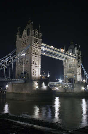 The Tower Bridge, London at night. photo