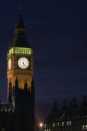 Big Ben at the Houses of parliament, London at night. photo