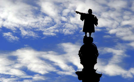 A Statue of Christopher Columbus against a blue sky. Stock Photo