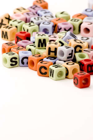 An assortment of letter cubes against a white background.