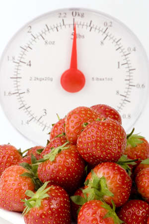 Ripe Strawberry's with Weight Scales shot against a plain background. Stock Photo - 701862