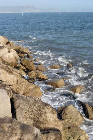 lyme: A rocky shoreline at Lyme regis, Devon. Stock Photo